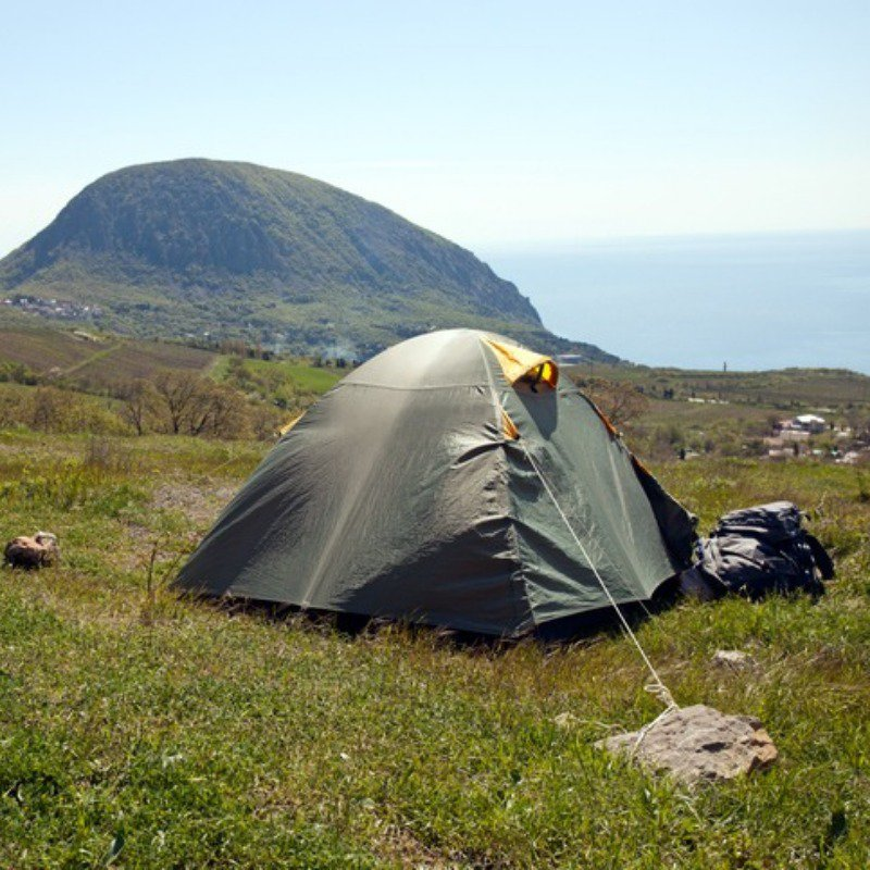 Tent on a hill near sea
