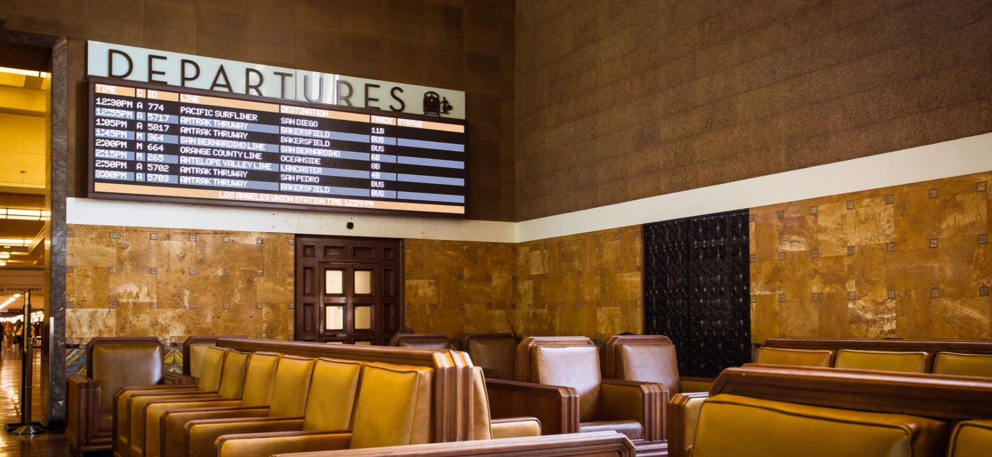 The departure board in the waiting area.