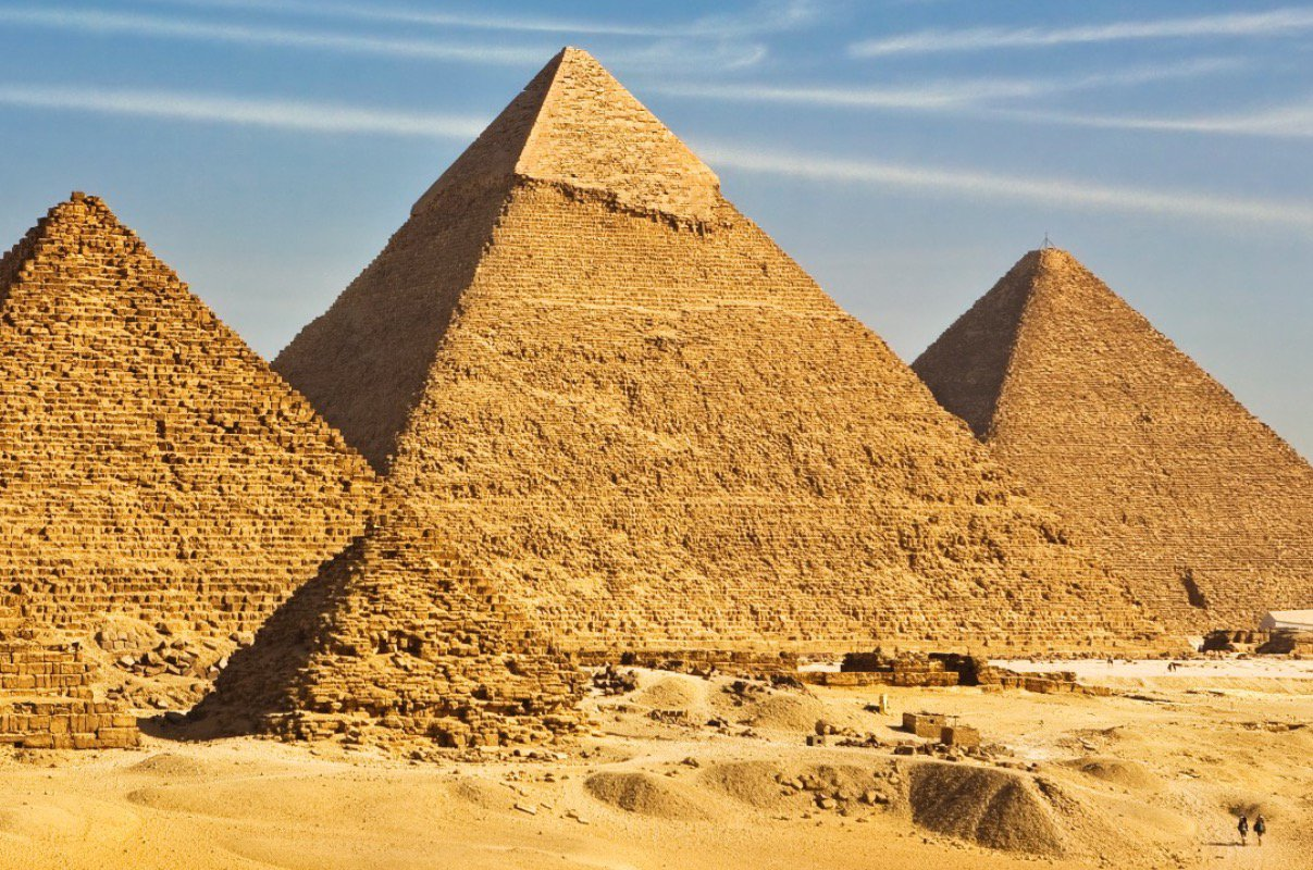 Tourists dwarfed by Pyramids.