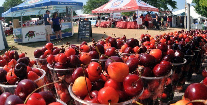 A display table of cherries at the Beaumont Cherry Festival