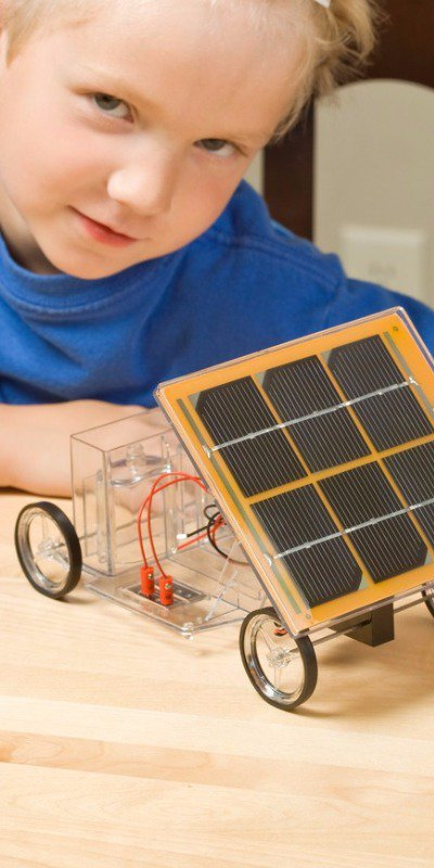 Kid with solar paneled car kit