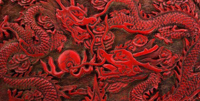 An ancient Chinese carving done with cinnabar.