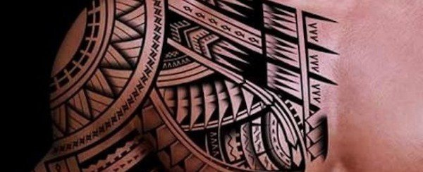 Tribal tattoo on chest and arm