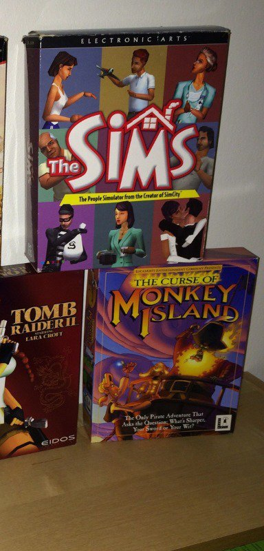 I have a special place in my heart for the original Sims box art.