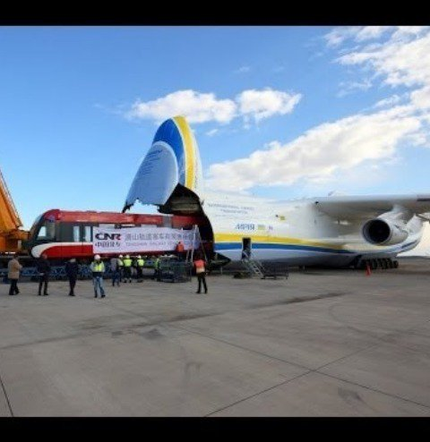 A train being loaded into a plane