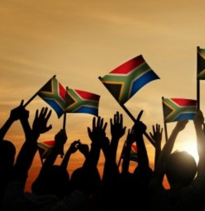 Beautiful image of people with the South African flag.