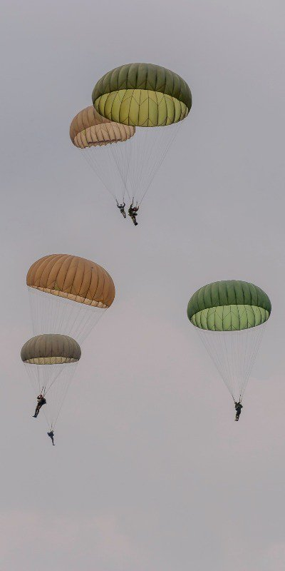Paratroopers dropping from the sky during Operation Market Garden