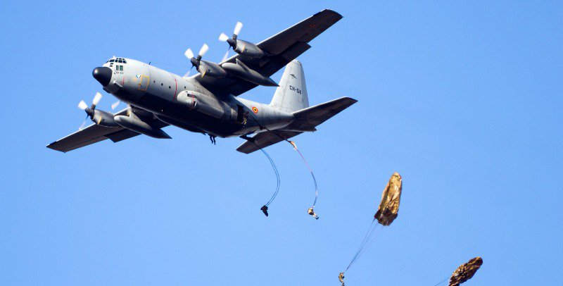 A shot of one of planes in the airborne forces dropping military men