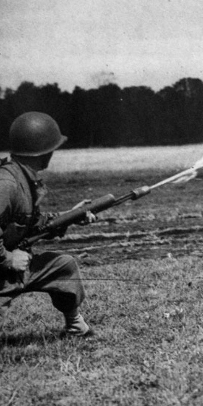 Soldier using a flamethrower in WWI.