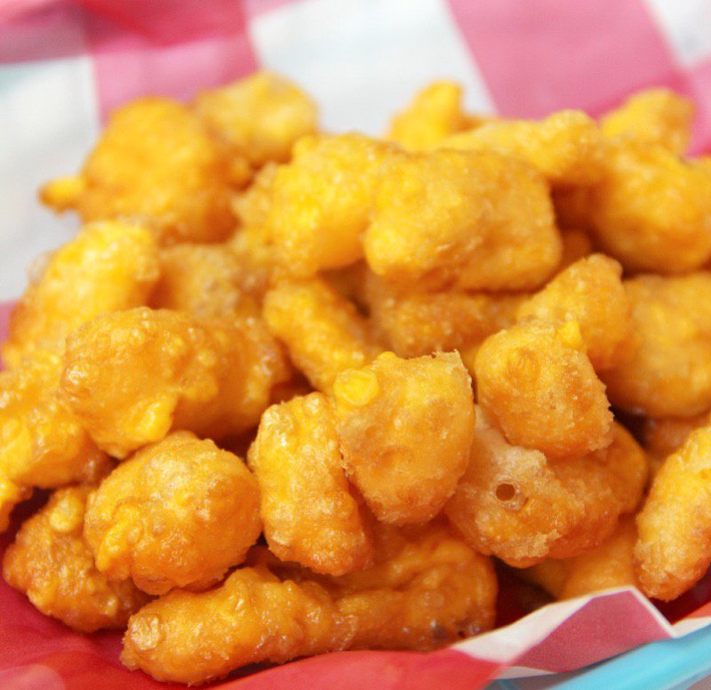 Fried cheese curds are a delicious entity you must have.