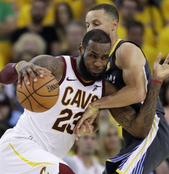 LeBron driving against Curry in Game 2.
